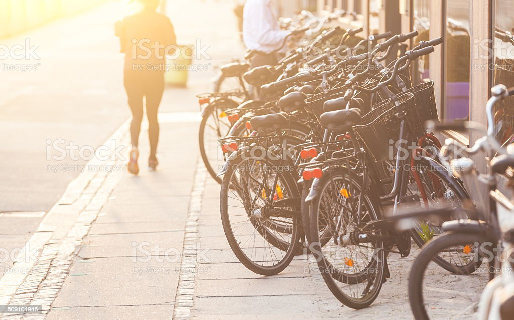 Bicycles parked along the road in Copenhagen stock photo