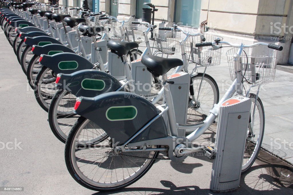 Bicycles parked at a bike sharing station stock photo