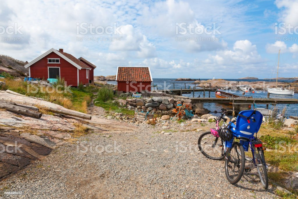 Bicycles parked at the cottages by the sea stock photo