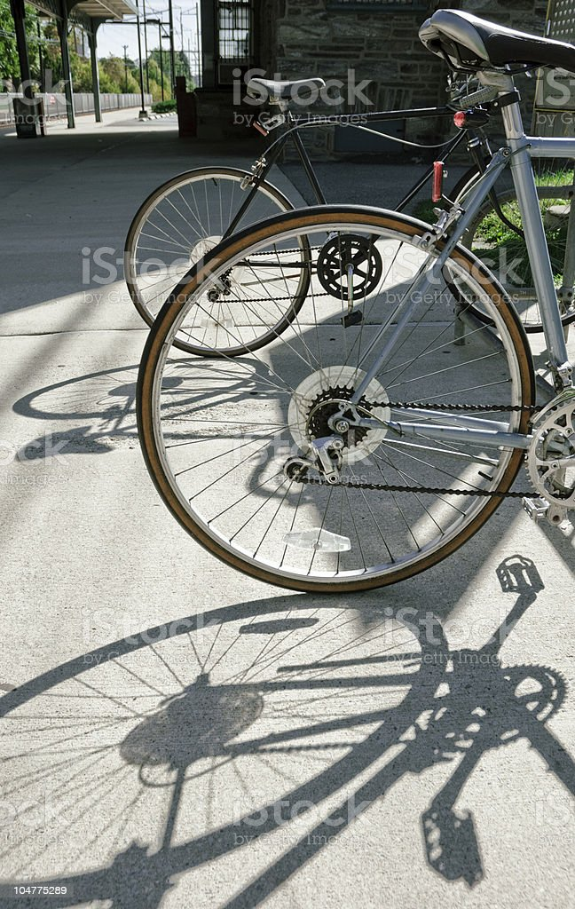 Bicycles; Parked bikes near train station royalty-free stock photo