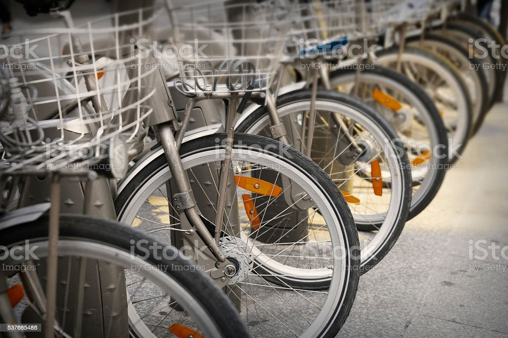 Bicycles parked in a row  along Paris street stock photo