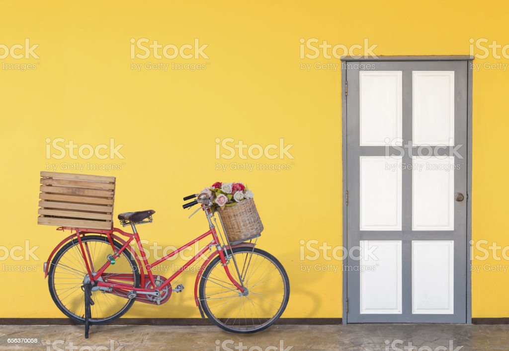Bicycles parked in front of the yellow room; stock photo