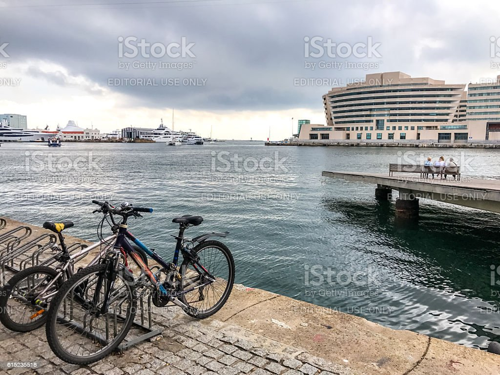 Bicycles parked in port Vell, Barcelona, Spain stock photo