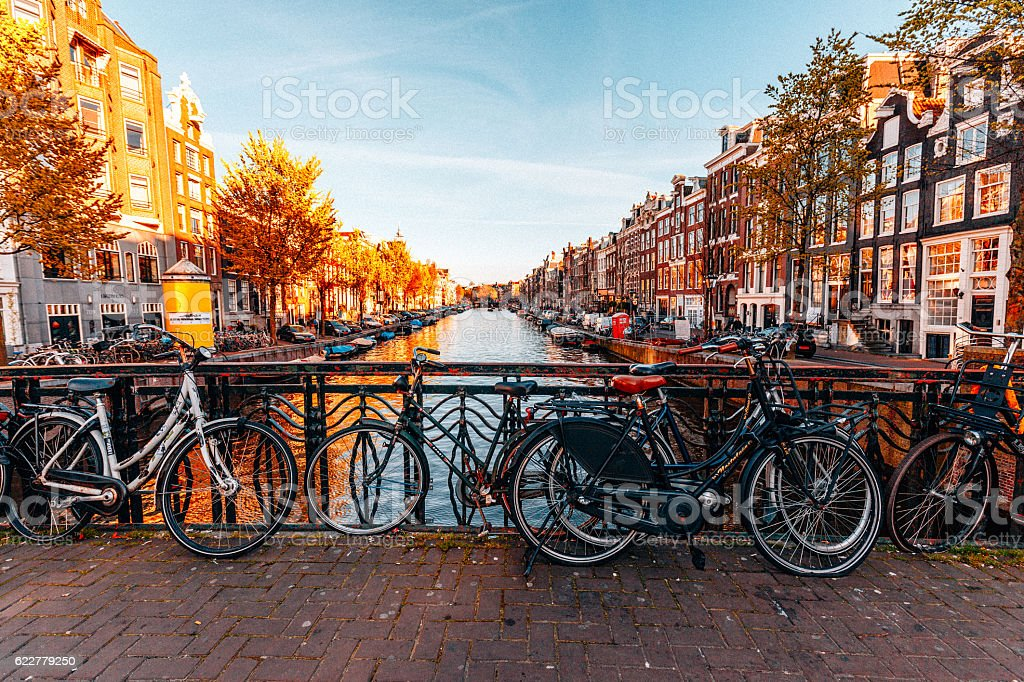 Bicycles parked on a bridge in Amsterdam stock photo
