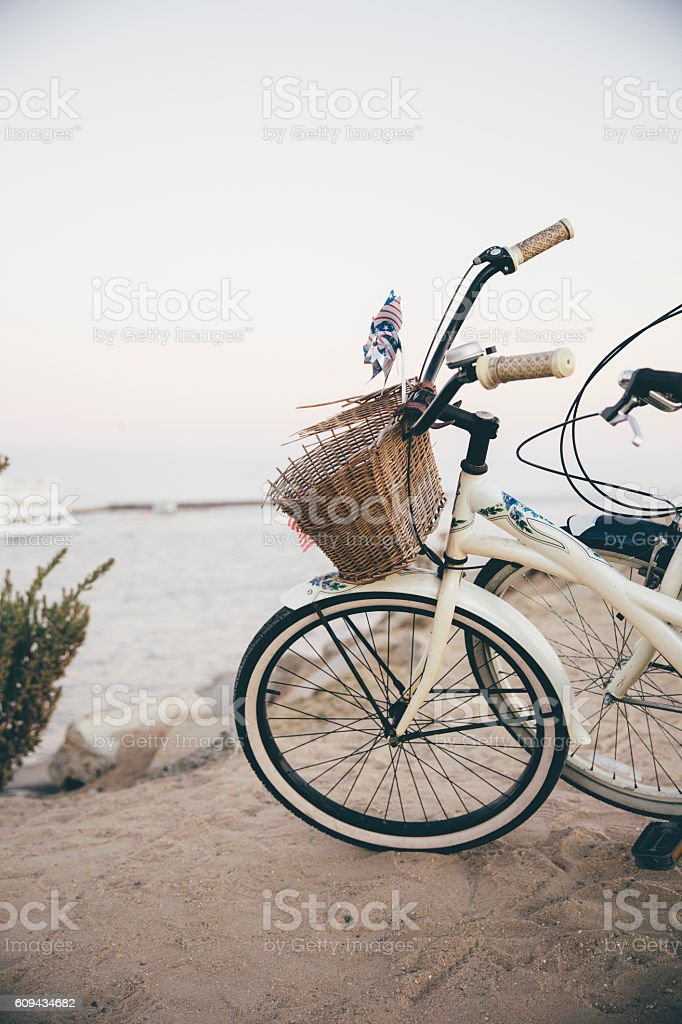 Bicycles Parked on Sand at the Beach stock photo