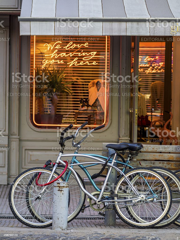 Bicycles parked outside shop royalty-free stock photo