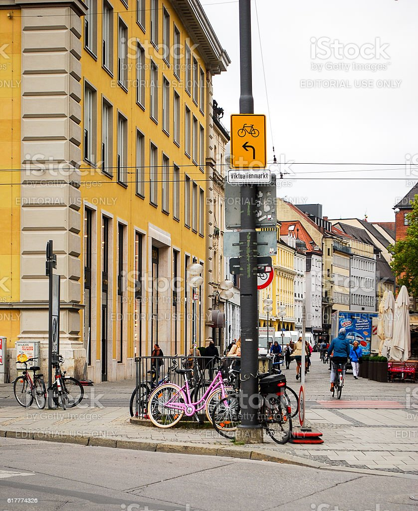 Bicycles stand chained to lampposts in Munich,Germany stock photo