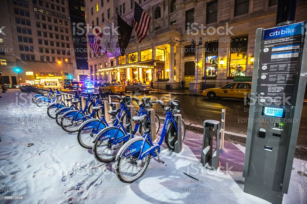 Bicycles under snow parked in New York, USA stock photo