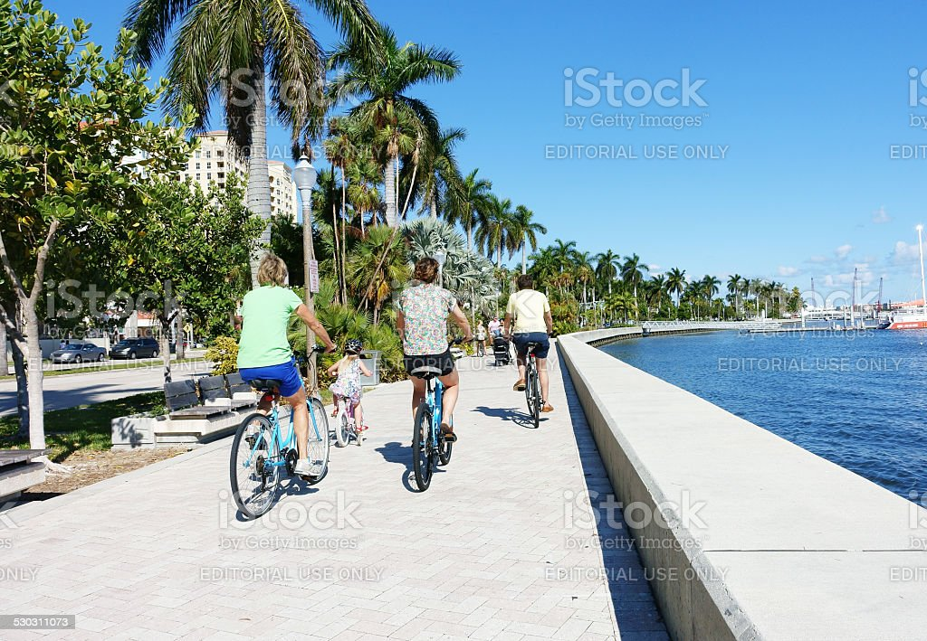 Bicycling along downtown West Palm Beach waterfront stock photo