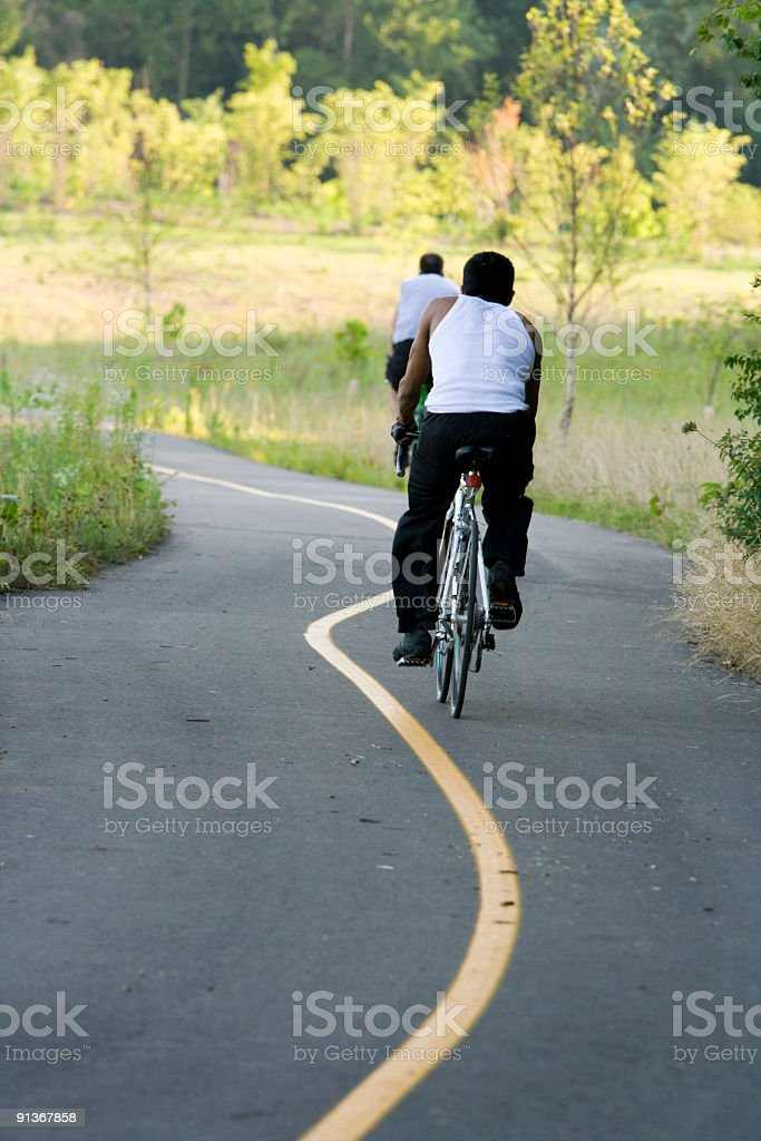 Bicycling in the park royalty-free stock photo