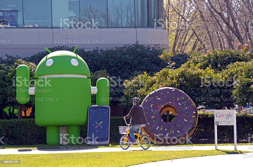 bicycling past Google Android stock photo