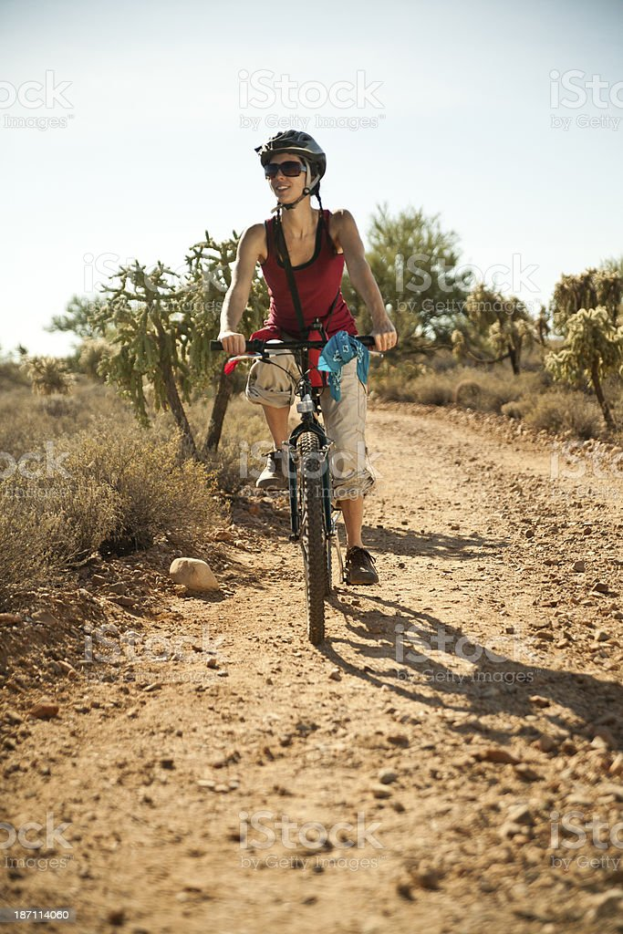 Bicycling Riding Down a Dirt Road royalty-free stock photo