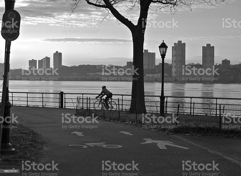 Bicyclist at sundown in Riverside Park, Manhattan, NYC stock photo