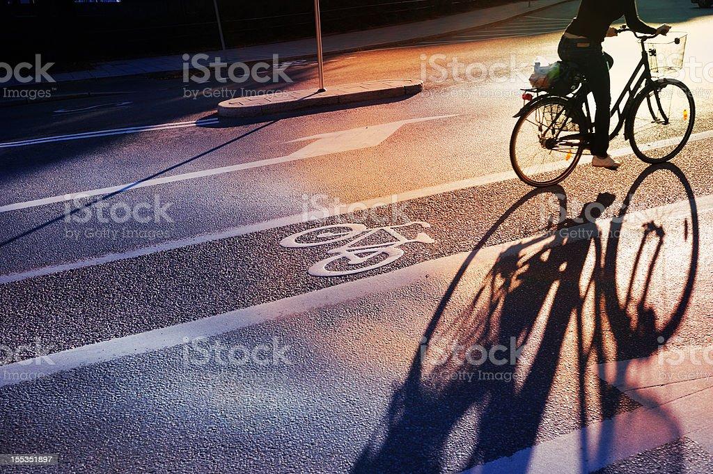 Bicyclist crossing bike lane royalty-free stock photo