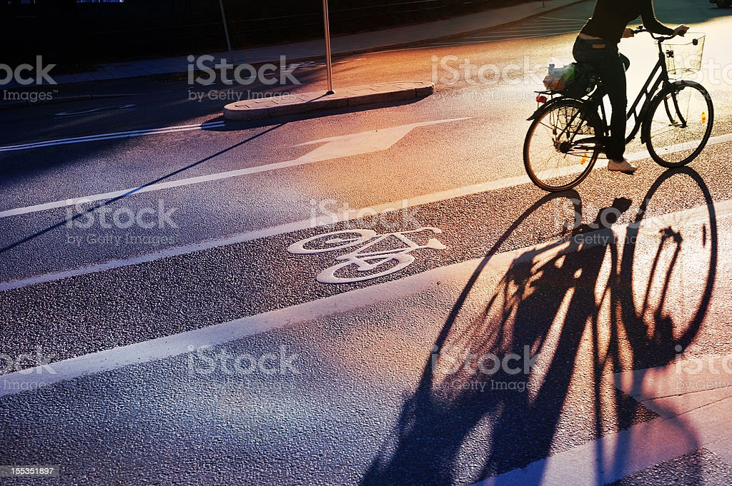 Bicyclist crossing bike lane stock photo