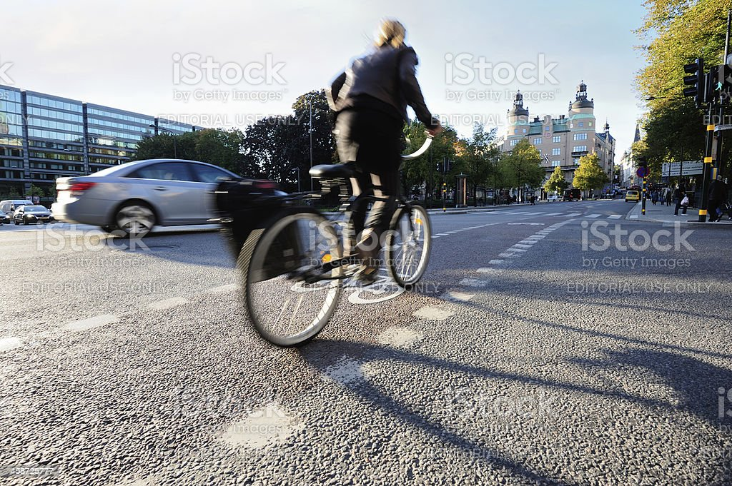 Bicyclist in bike lane royalty-free stock photo