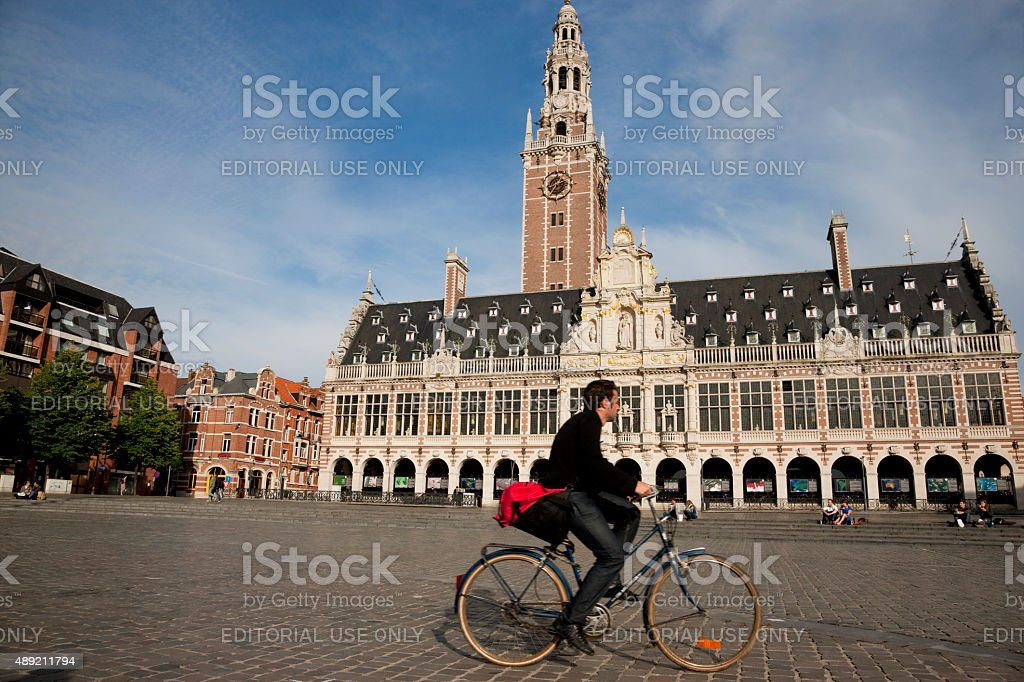 Bicyclist in front of the old library stock photo