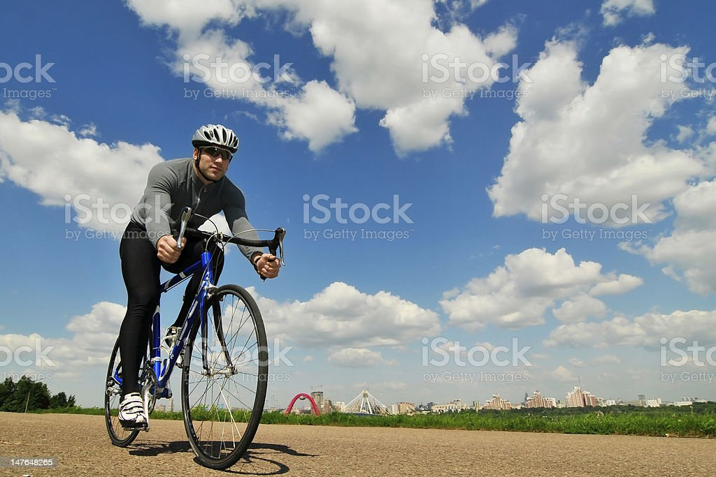 bicyclist on a background of the blue sky royalty-free stock photo