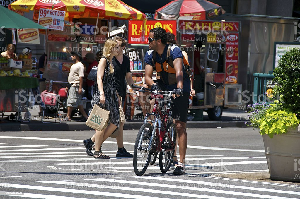 Bicyclist & pedestrians, 23rd St, Manhattan, New York City royalty-free stock photo