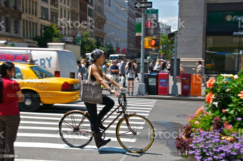 Bicyclist & pedestrians at E.23rd St, Manhattan, NYC stock photo