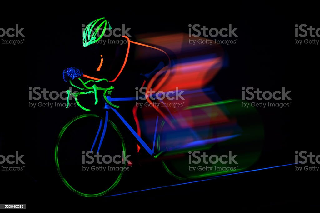 Bicyclist ride bike colored with fluorescent color stock photo