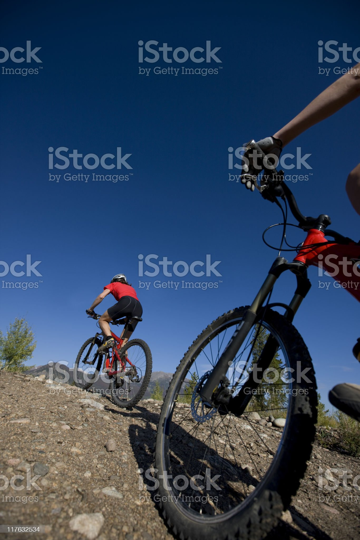 Bicyclist Riding  Up Rugged Terrain royalty-free stock photo