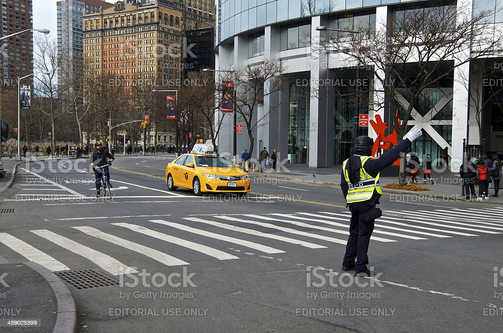 Bicyclist, Traffic Officer, Taxi, State Street, Lower Manhattan, NYC stock photo