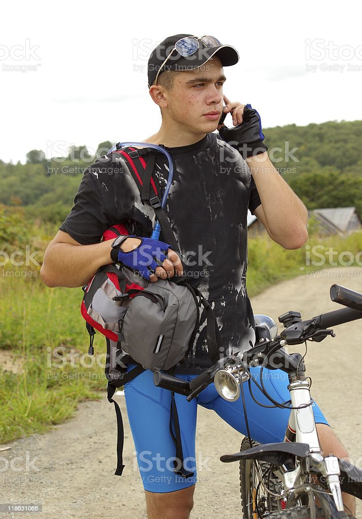 Bicyclist with telephone royalty-free stock photo