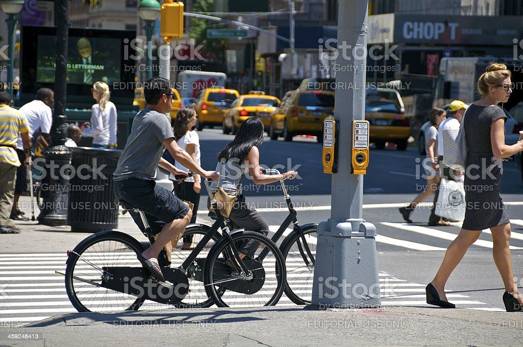 Bicyclists & pedestrians at E.23rd St, Manhattan, NYC stock photo