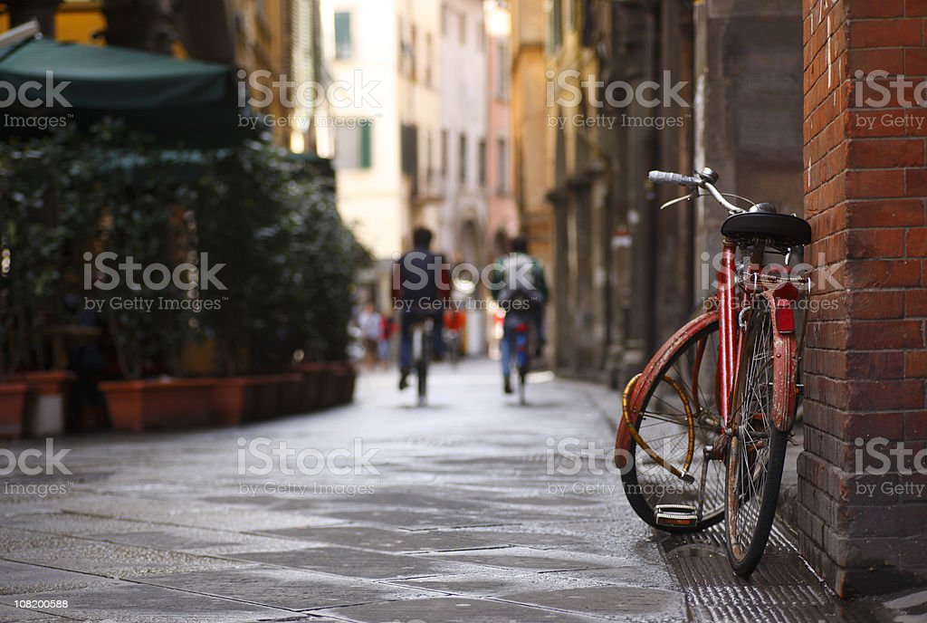 Bicying Leaning Against Brick Wall in Pisa, Italy royalty-free stock photo