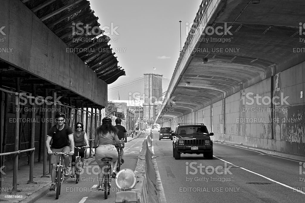 Bicylists along Furman Street, Brooklyn Heights, New York City royalty-free stock photo