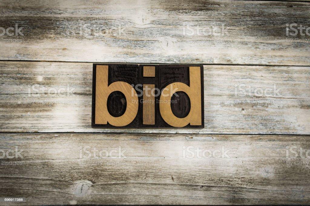 Bid Letterpress Word on Wooden Background stock photo