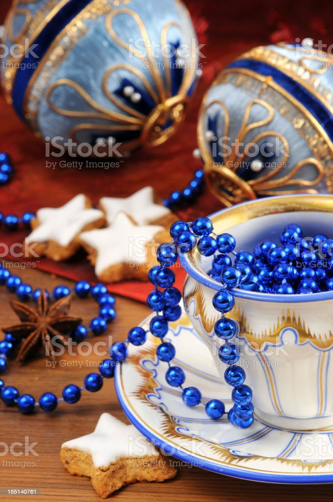 Biedermeier porcelain cup with old Christmas ornaments cookies stock photo