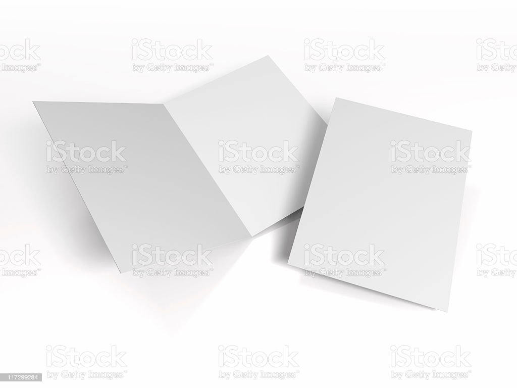 Bifold pieces of paper on a white background royalty-free stock photo