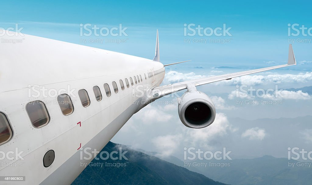 Big airliner in the sky stock photo