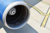 Big airplane engine detail on runway