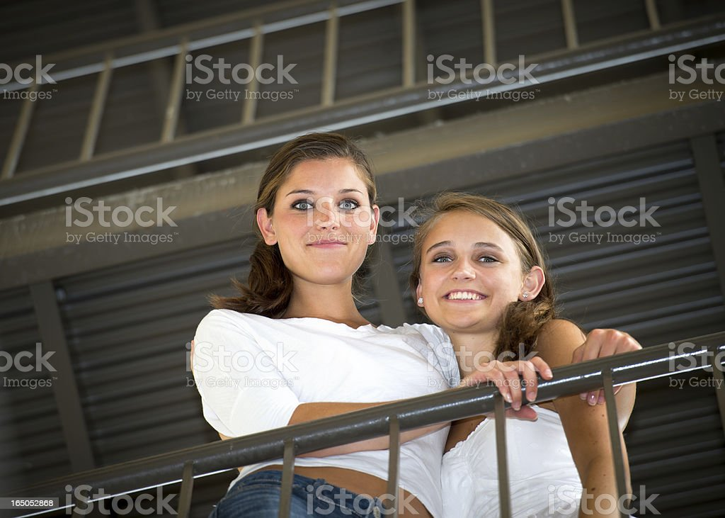 Big and Little Sister in Urban Setting stock photo