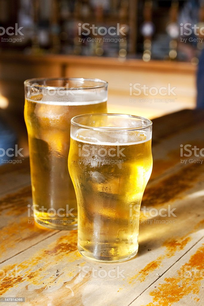Big and small beers royalty-free stock photo