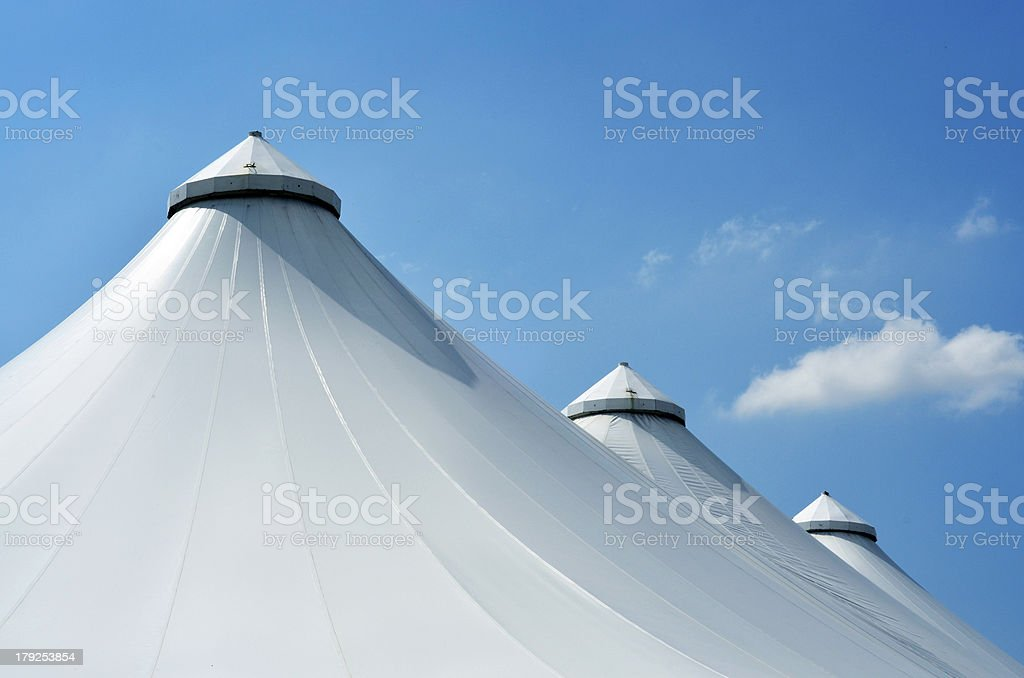 big architectural tents against blue sky royalty-free stock photo