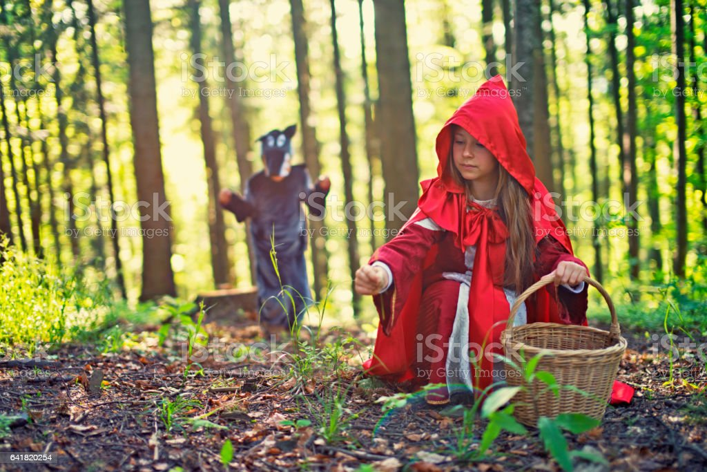 Big Bad Wold sneaking on Little Red Riding Hood stock photo
