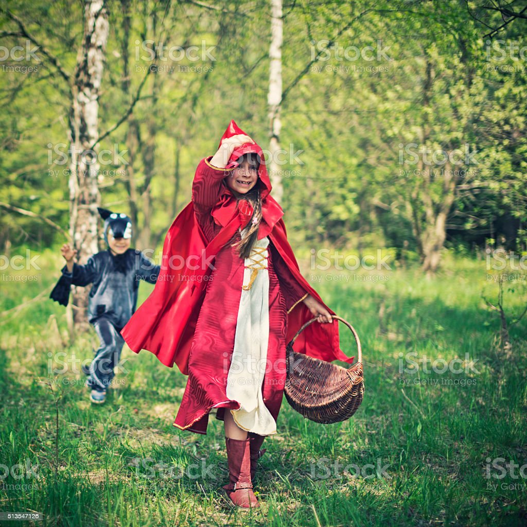 Big Bad Wolf chasing the Little Red Riding Hood stock photo
