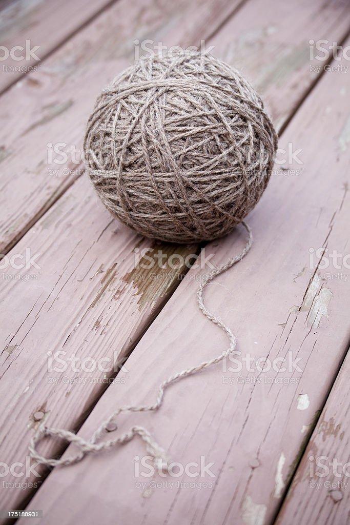 Big Ball of Gray Wool Yarn On Rustic Wood Background stock photo