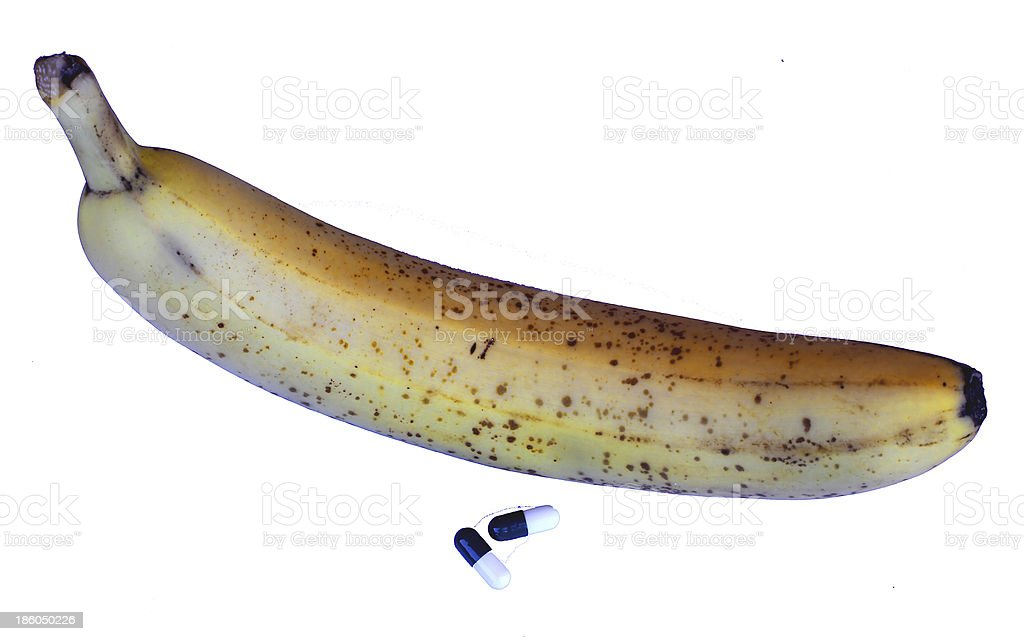 big banana with pills for male issues royalty-free stock photo