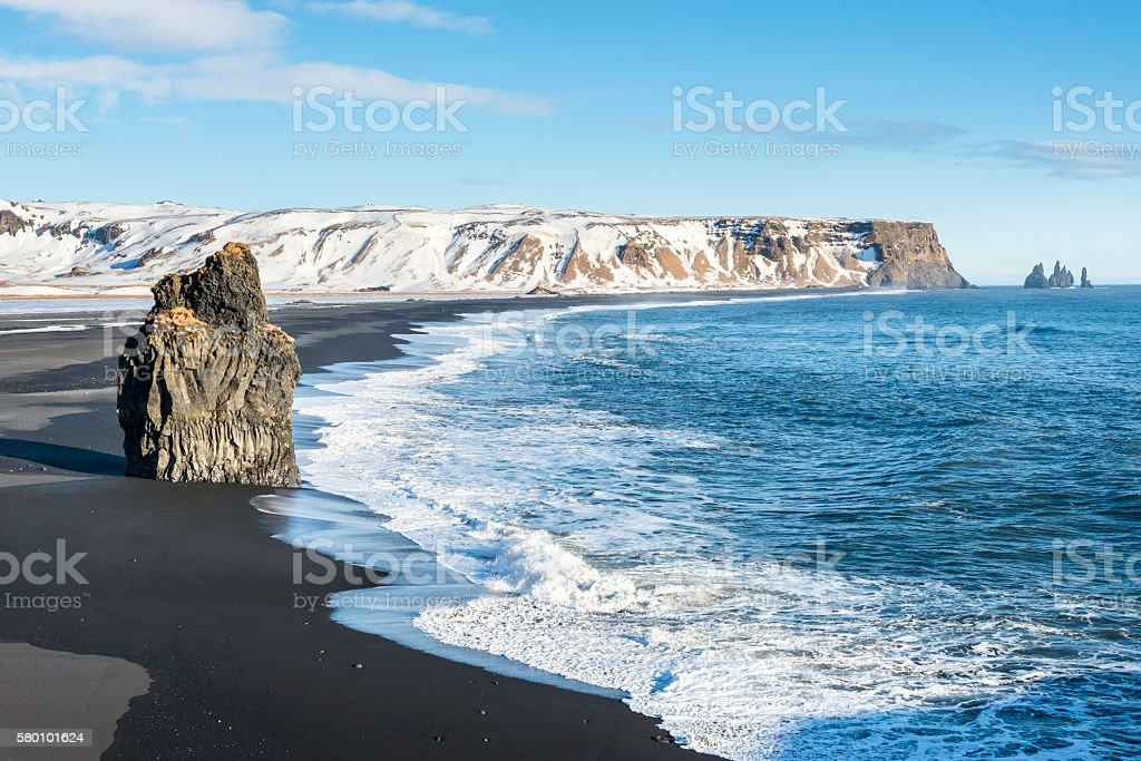 Big basalt rock on the Reynisfjara black sand beach, Iceland. stock photo