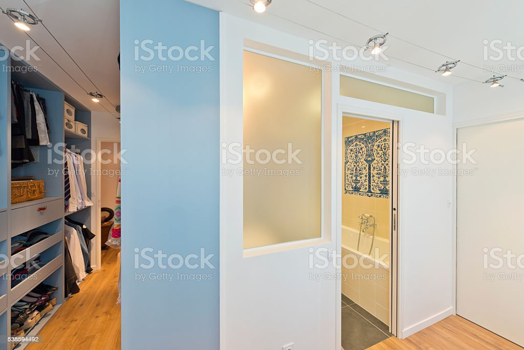 Big beautiful walk in wardrobe. Luxury modern home stock photo