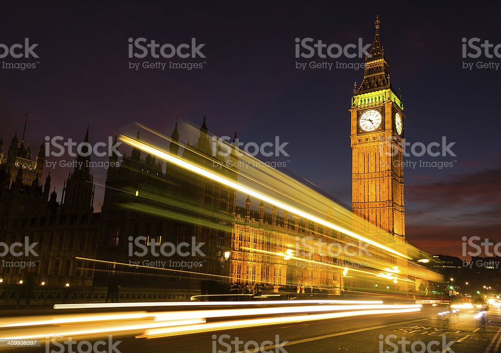 Big Ben and a light trail at dusk stock photo