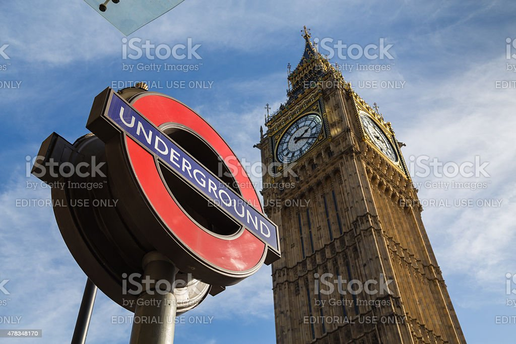 Big Ben (Elizabeth Tower) and a London Underground Sign stock photo