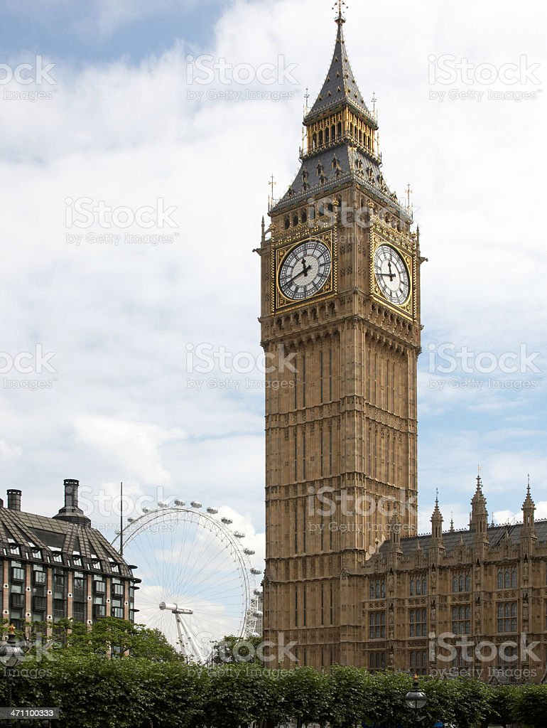 Big Ben and London Eye in the background royalty-free stock photo