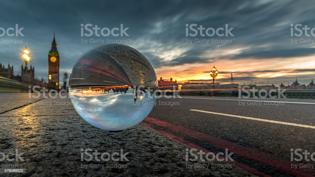 Big Ben and Westminster Bridge, seen with a crystal ball stock photo