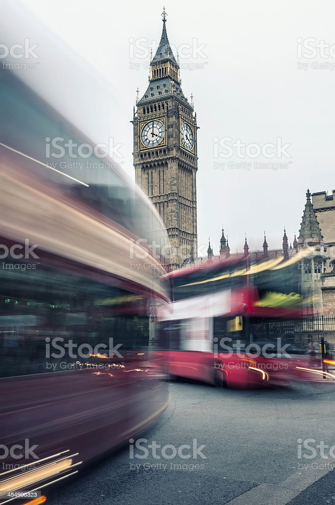 Big Ben at dusk with passing Double Decker buses (I) royalty-free stock photo